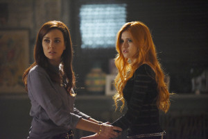 """SHADOWHUNTERS - """"The Mortal Cup"""" - One young woman realizes how dark the city can really be when she learns the truth about her past in the series premiere of """"Shadowhunters"""" on Tuesday, January 12th at 9:00 - 10:00 PM ET/PT. ABC Family is becoming Freeform in January 2016. Based on the bestselling young adult fantasy book series The Mortal Instruments by Cassandra Clare, """"Shadowhunters"""" follows Clary Fray, who finds out on her birthday that she is not who she thinks she is but rather comes from a long line of Shadowhunters - human-angel hybrids who hunt down demons. Now thrown into the world of demon hunting after her mother is kidnapped, Clary must rely on the mysterious Jace and his fellow Shadowhunters Isabelle and Alec to navigate this new dark world. With her best friend Simon in tow, Clary must now live among faeries, warlocks, vampires and werewolves to find answers that could help her find her mother. Nothing is as it seems, including her close family friend Luke who knows more than he is letting on, as well as the enigmatic warlock Magnus Bane who could hold the key to unlocking Clary's past. (ABC Family/John Medland) MAXIM ROY, KATHERINE MCNAMARA"""
