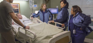 """GREY'S ANATOMY - """"All Eyez On Me"""" - Meredith, Bailey, Jackson, Callie and Jo travel to a military hospital to perform an extraordinary and extremely risky surgery on a veteran with an advanced tumor. Meanwhile back at Grey Sloan, Andrew is tired of being Maggie's worst kept secret; Ben makes an impulsive surgical decision; and a team of cheerleaders wreak havoc in the ER, on """"Grey's Anatomy,"""" THURSDAY, MARCH 10 (8:00-9:00 p.m. EST) on the ABC Television Network. (ABC/Ron Batzdorff) SCOTT ELROD, BRETT ZIMMERMAN, ELLEN POMPEO, SARA RAMIREZ, CHANDRA WILSON"""