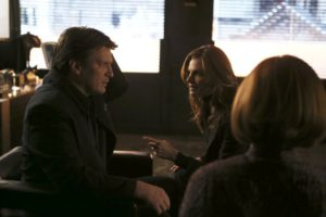 """CASTLE - """"Hell to Pay"""" - When an axe-wielding, escaped psychiatric inmate drops dead in Castle's P.I. office, Castle and Beckett's investigation leads Castle to suspect the victim's death could be the work of the Antichrist, on """"Castle,"""" MONDAY, MAY 9 (10:00-11:00 p.m. EDT), on the ABC Television Network. (ABC/Scott Everett White) NATHAN FILLION, STANA KATIC"""